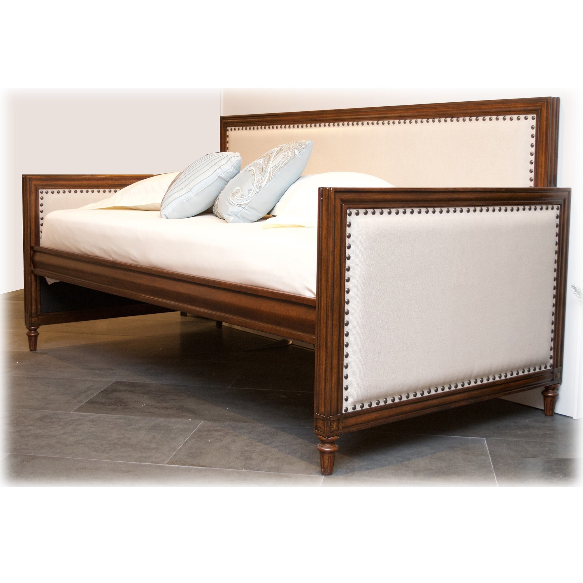grandover wood daybed with nailhead trim and cream upholstery