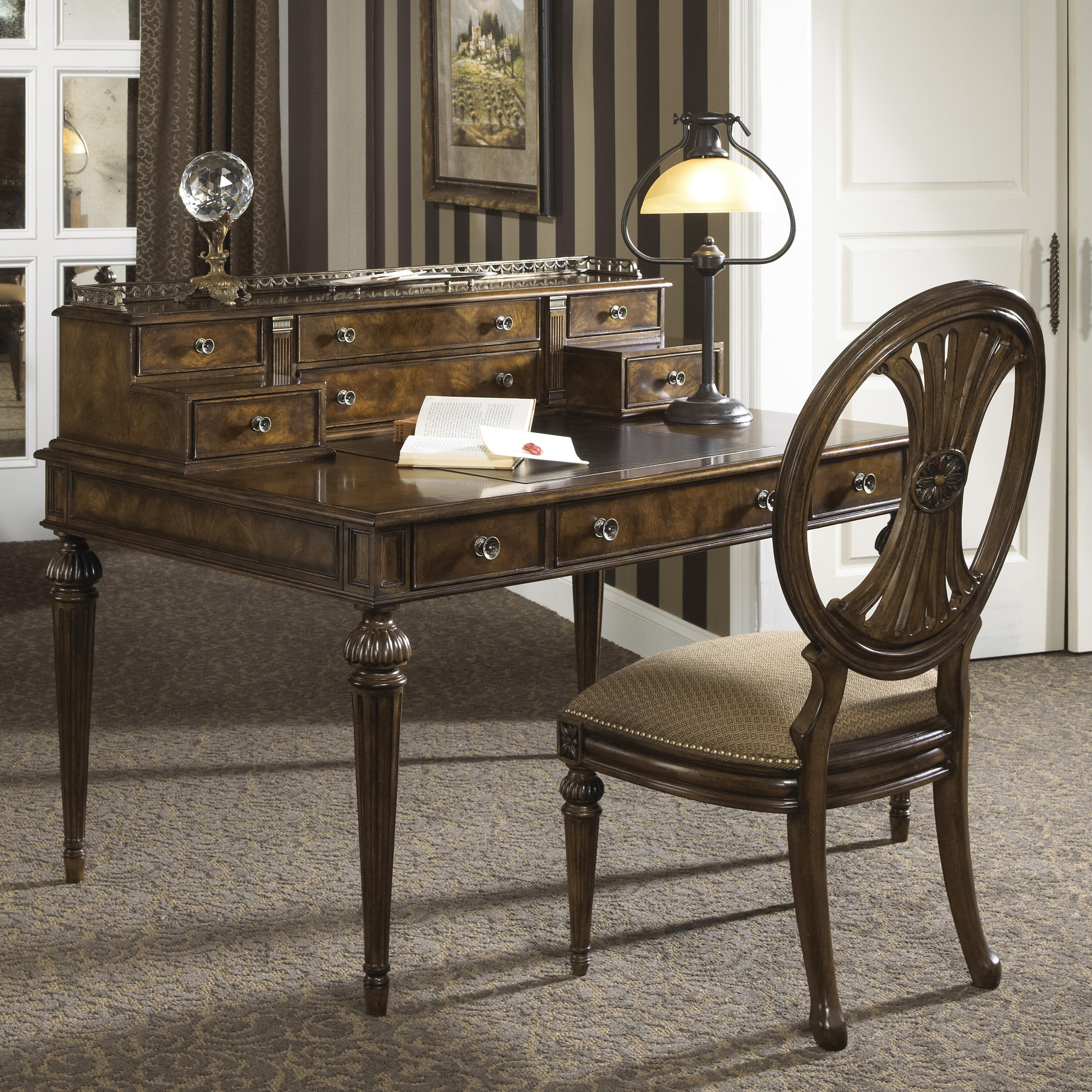 traditional syle writing desk with nine drawers and leather top