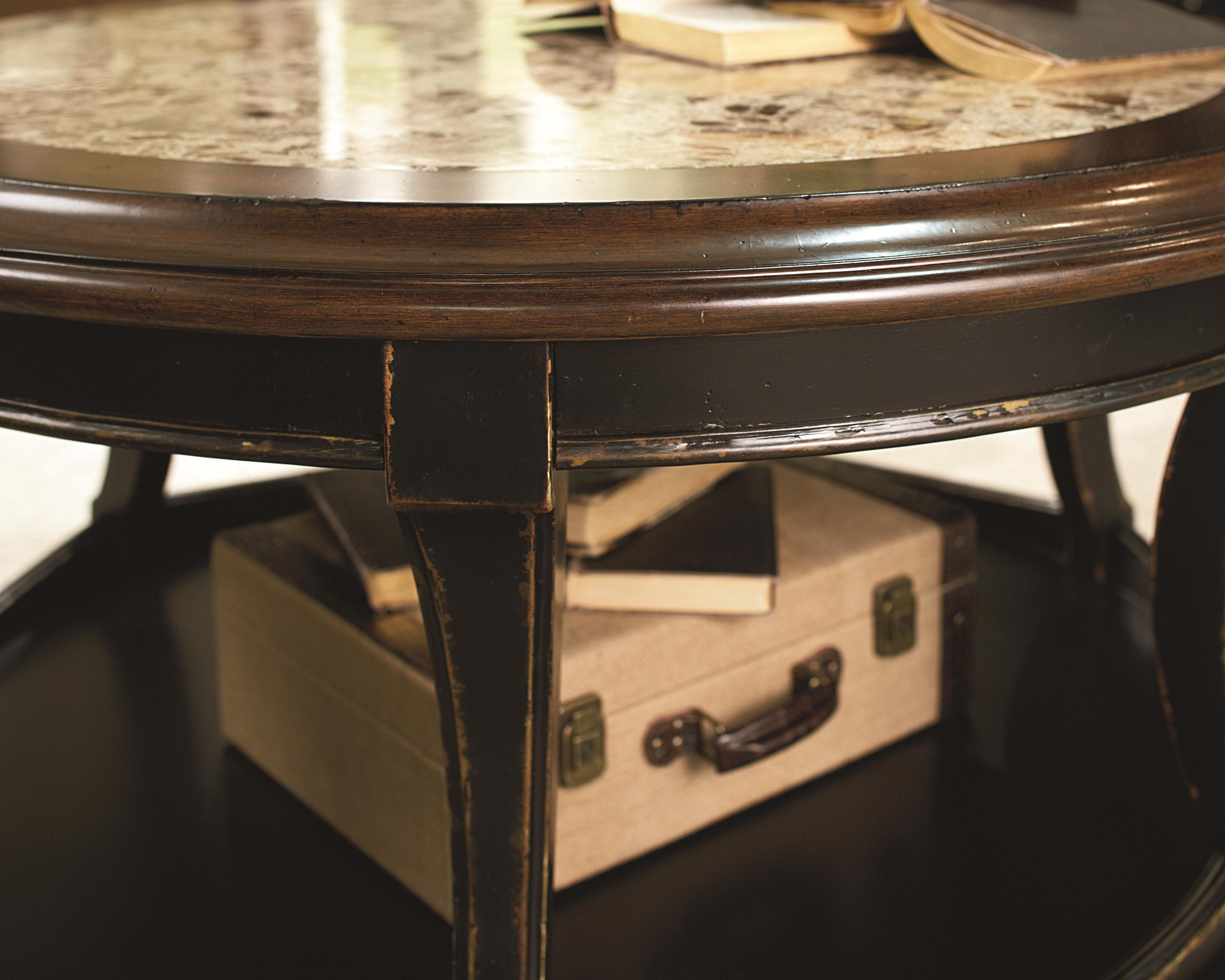 Inlay Coffee Table ~ Round cocktail table with top stone inlay by hammary