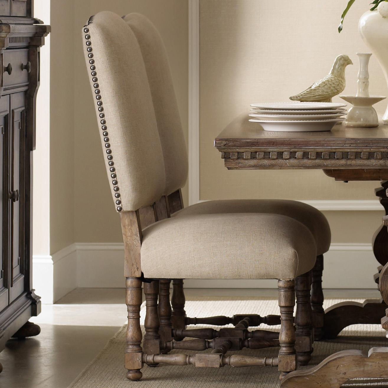 Upholstered Dining Side Chair With Turned Stretcher And Nailhead Trim