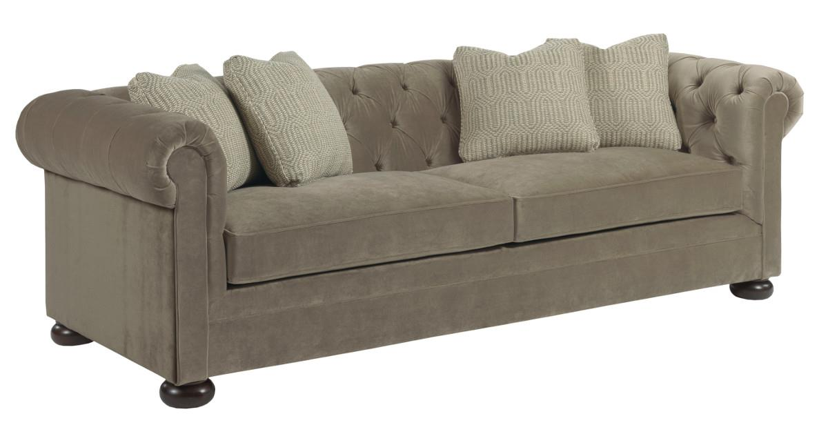 Captivating Chesterfield Sofa With Toss Pillows And Wooden Bun Feet