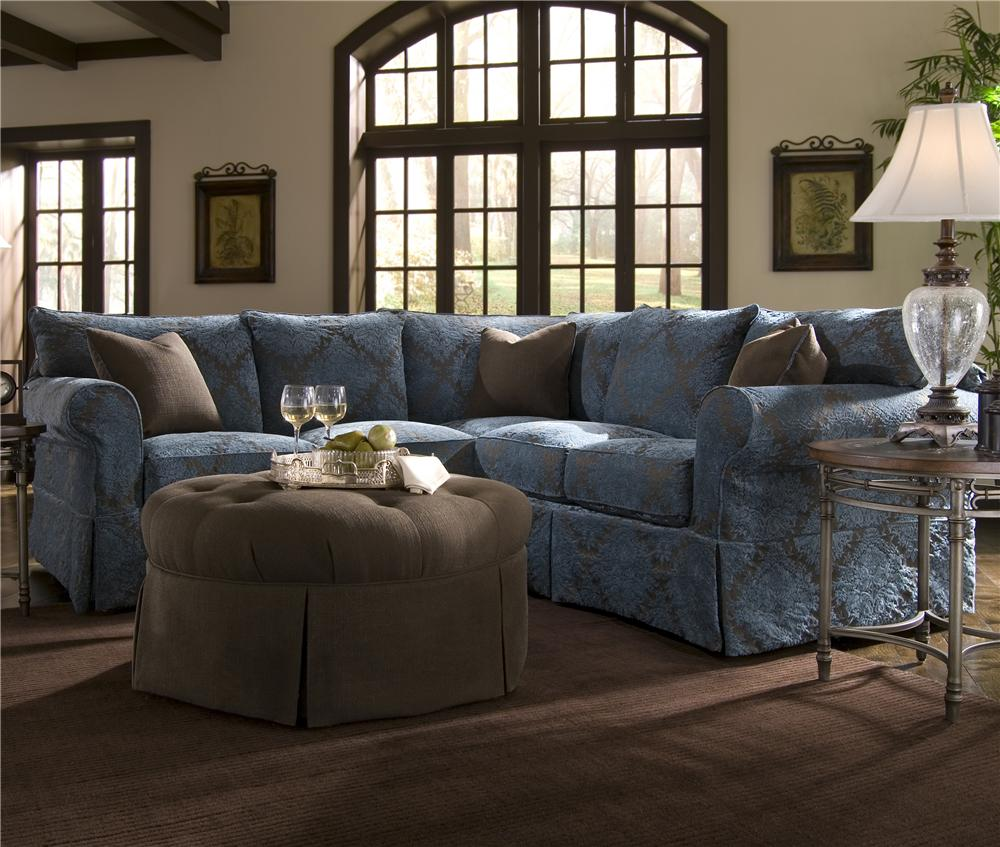 Slipcover Sectional With Rolled Arms And Skirt By