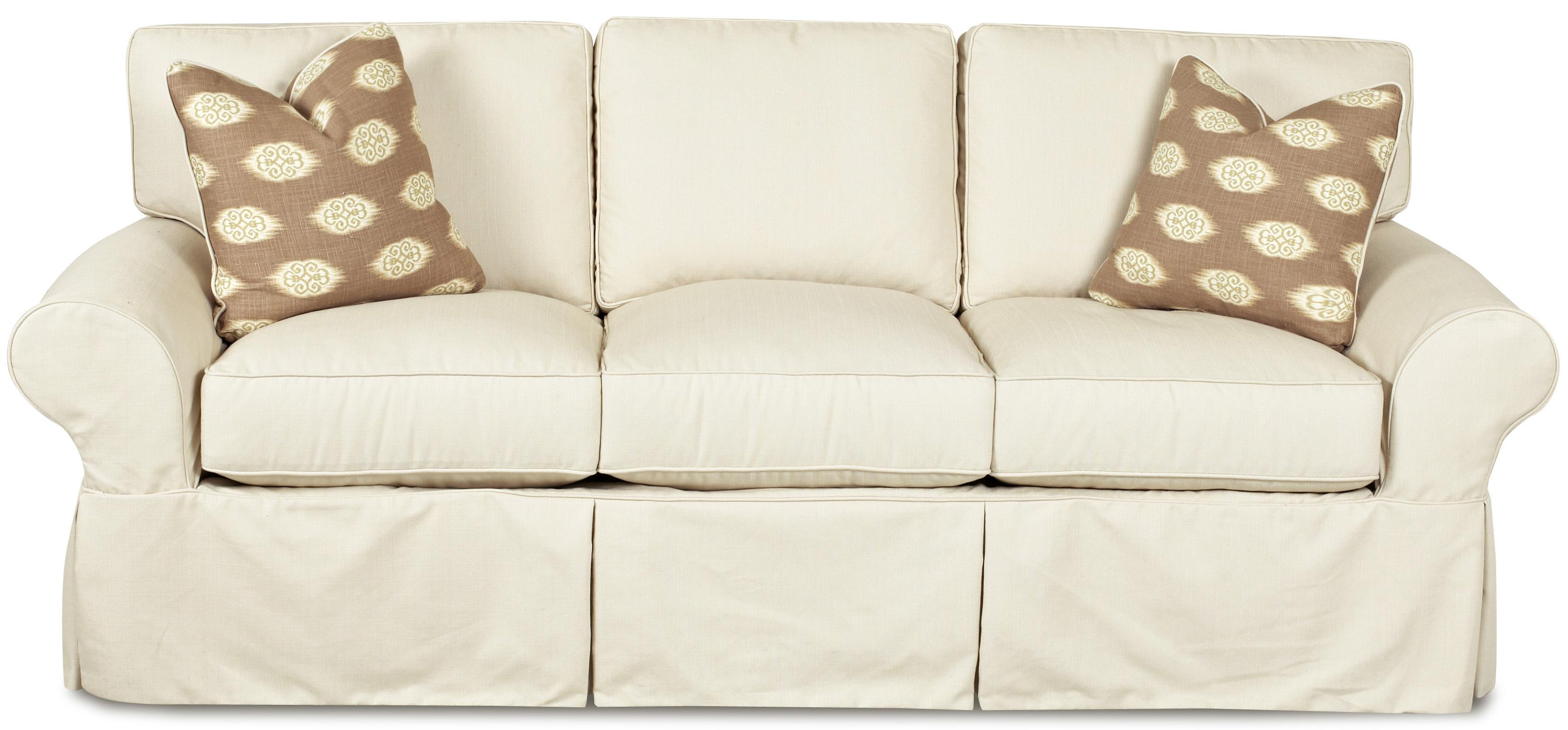 slipcovered sofa with rolled arms and tailored skirt
