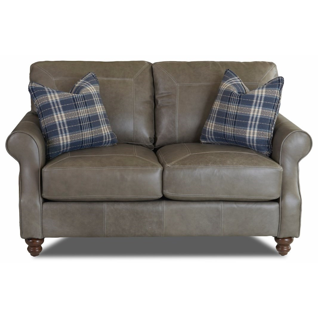 Traditional Loveseat with Rolled Arms and Pillows