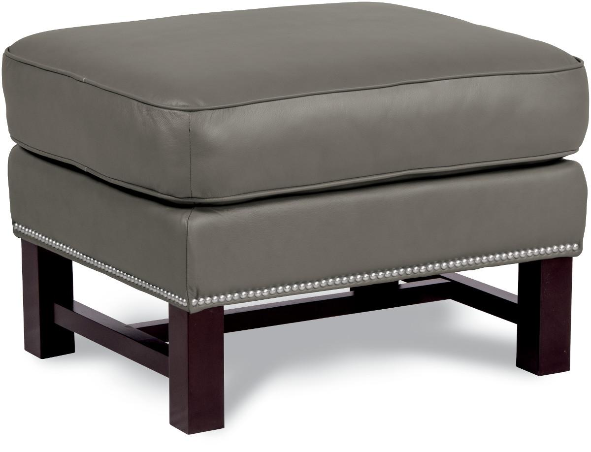 Cosmopolitan Ottoman with Nailheads and Exposed Wood Trim