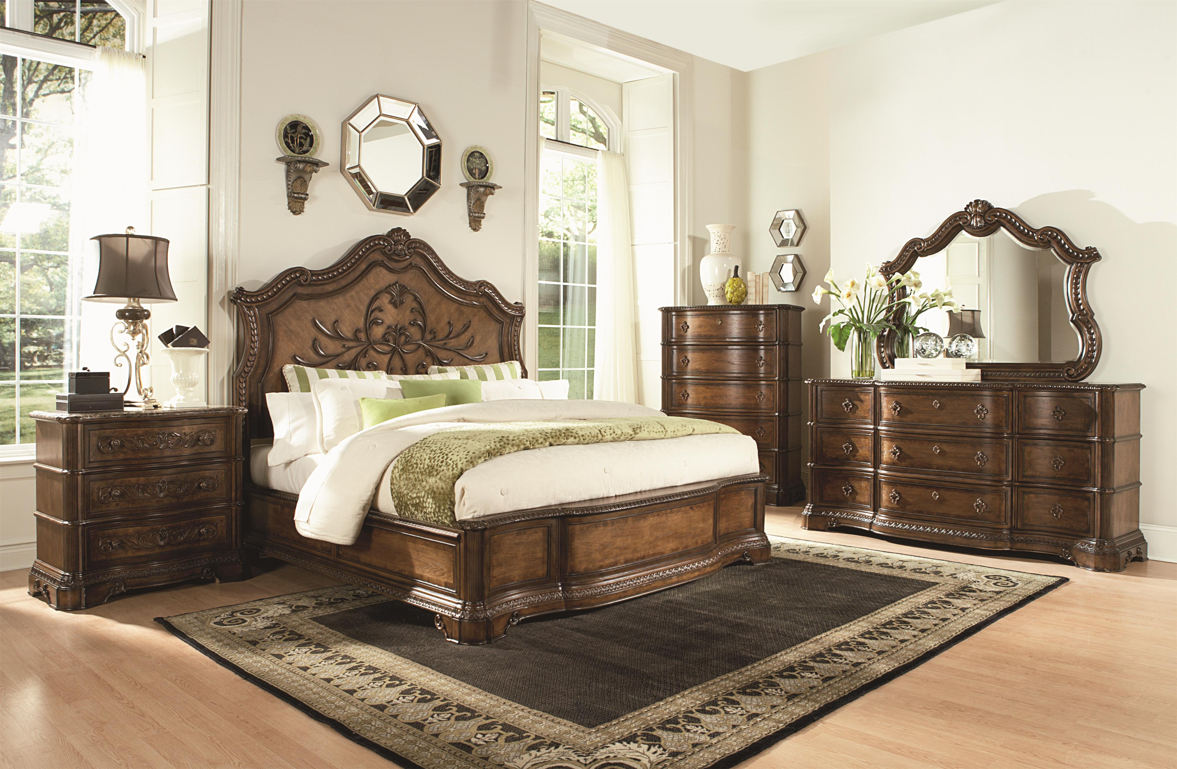 arched mirror with ornamental carved details by legacy classic