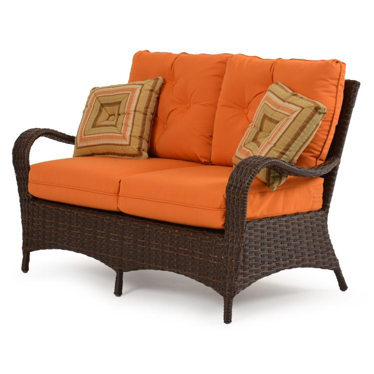 wicker loveseat w throw pillows