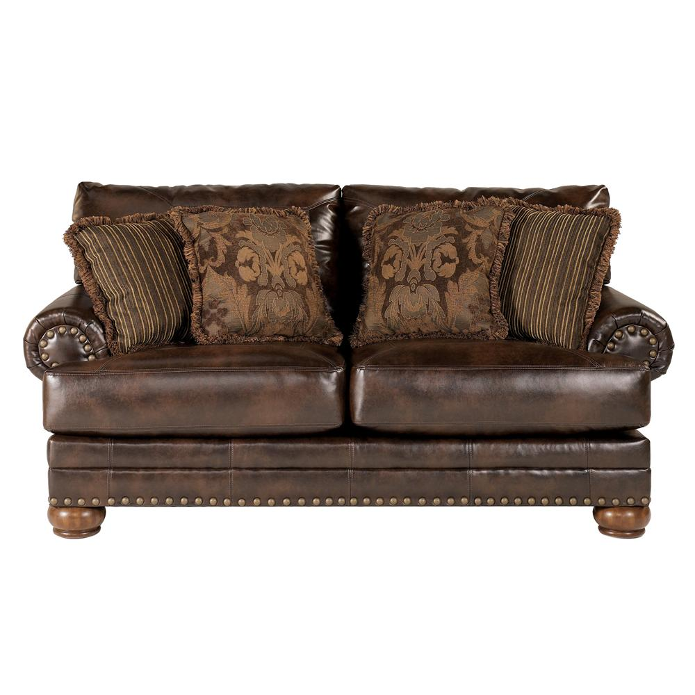 Loveseat with nailhead trim by signature design by ashley wolf and gardiner wolf furniture Ashley couch and loveseat