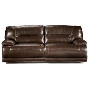 Signature Design by Ashley Exhilaration - Chocolate Reclining 2-Seat Leather Sofa