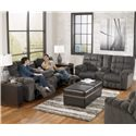 Signature Design by Ashley Acieona - Slate Reclining Sofa with Drop Down Table and Cup Holders - Shown with Coordinating Collection Loveseat. Rocker Recliner Shown in Right Corner.