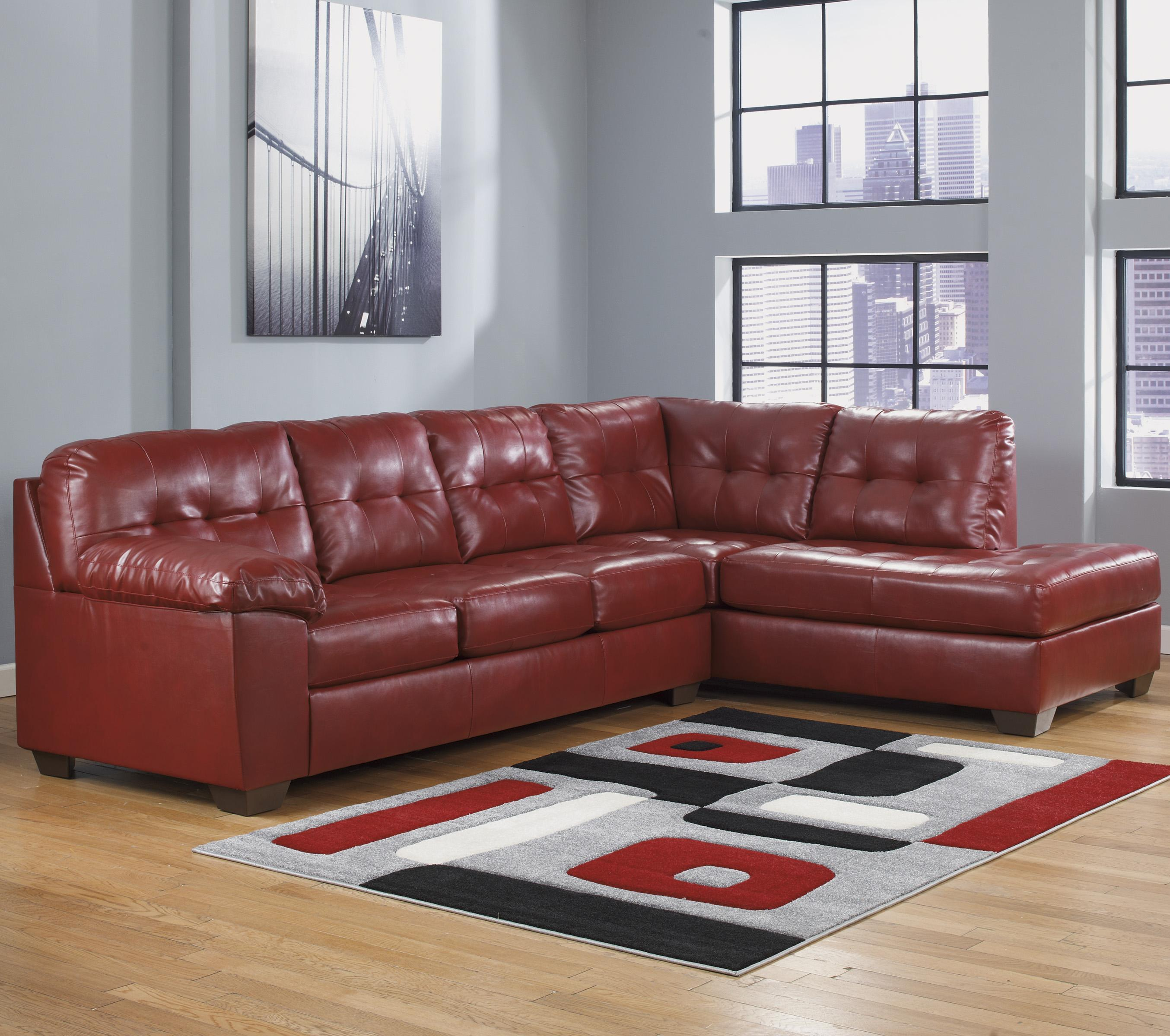 Faux leather sectional w right chaise tufting by for Ashley leather sectional with chaise