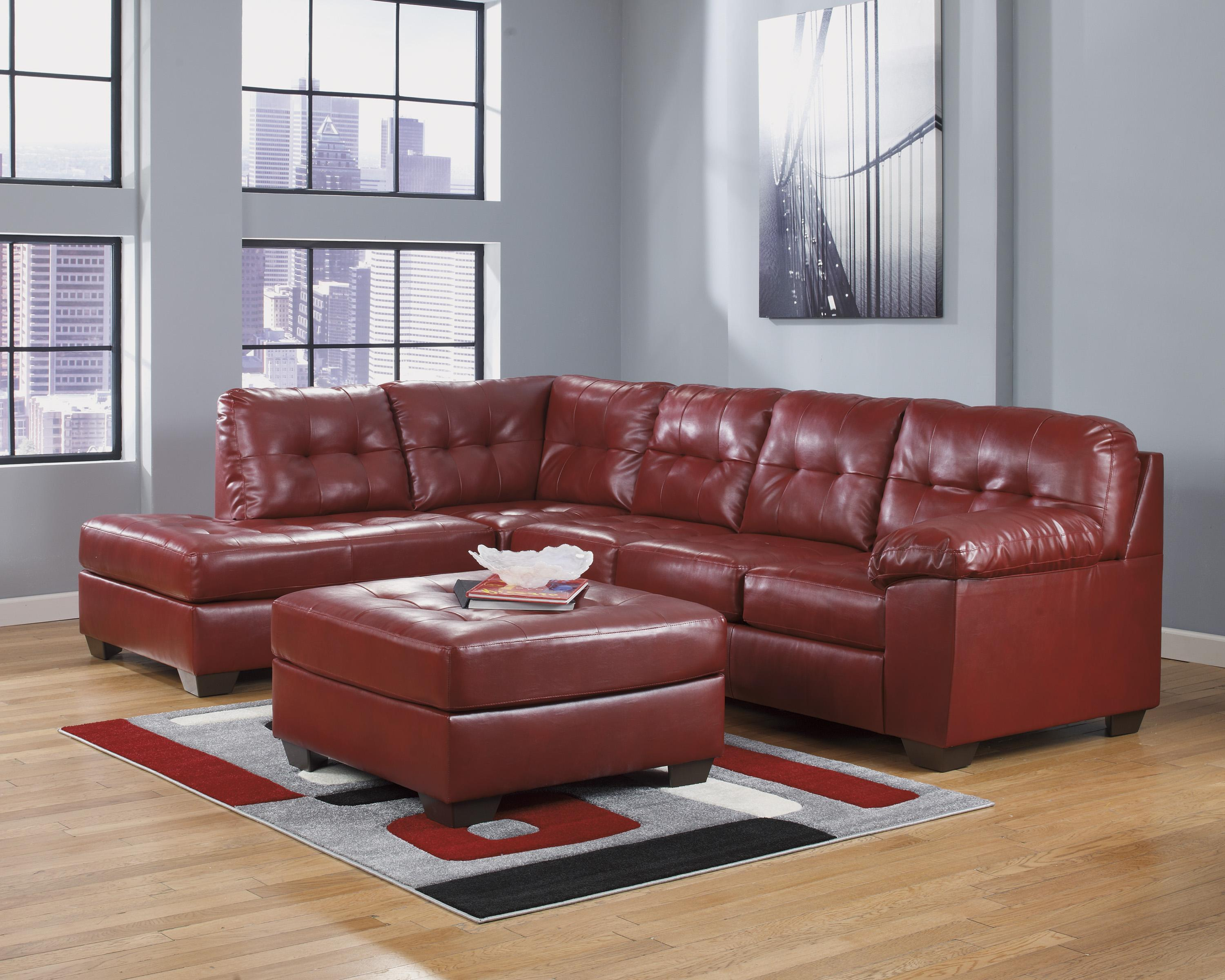 Faux leather sectional w left chaise tufting by for Ashley furniture leather chaise