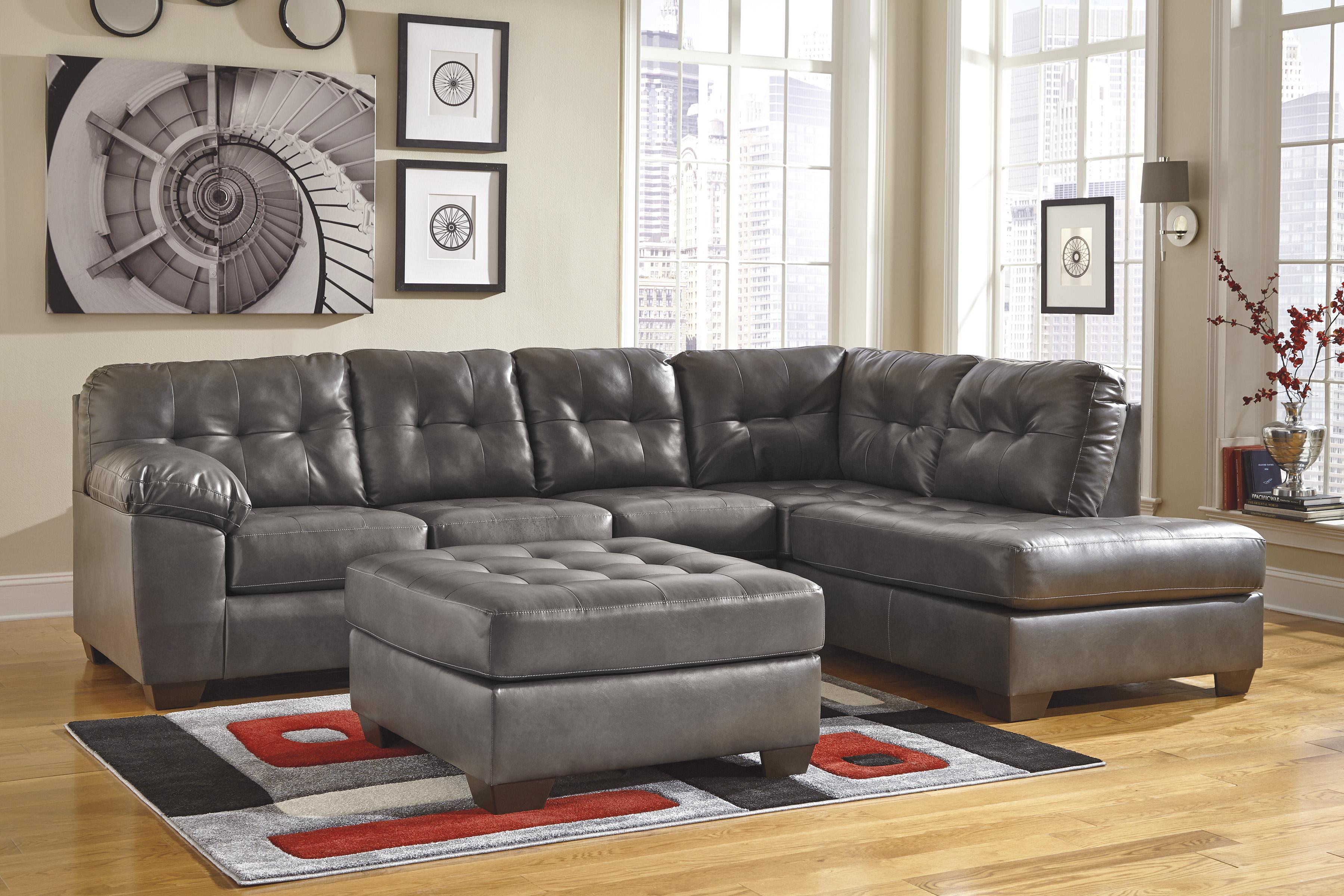 Faux leather sectional w right chaise tufting by for Ashley furniture chaise lounge couch