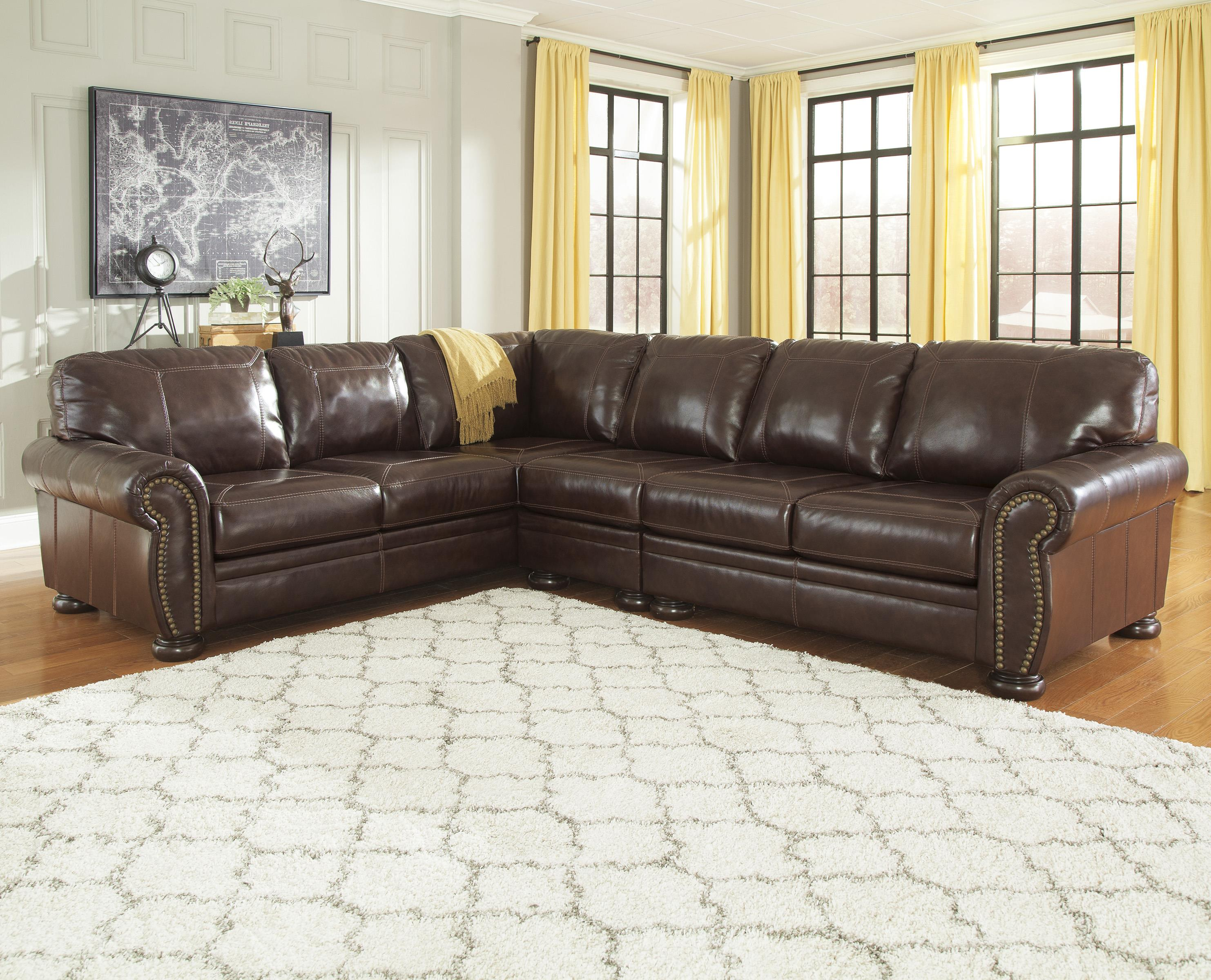 3 Piece Leather Match Sectional with Rolled Arms Nailhead Trim