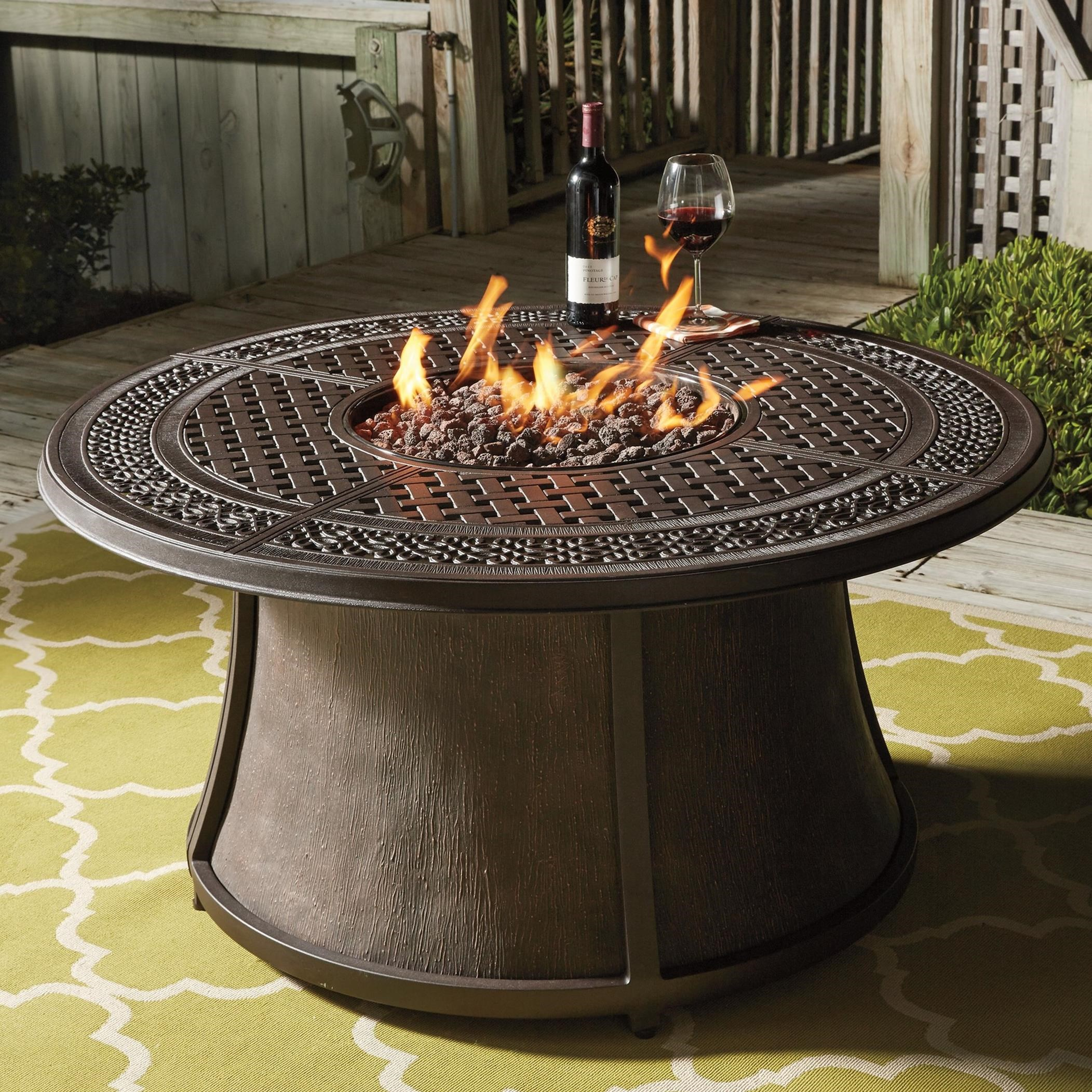 round fire pit table Outdoor Round Fire Pit Table by Signature Design by Ashley | Wolf  round fire pit table