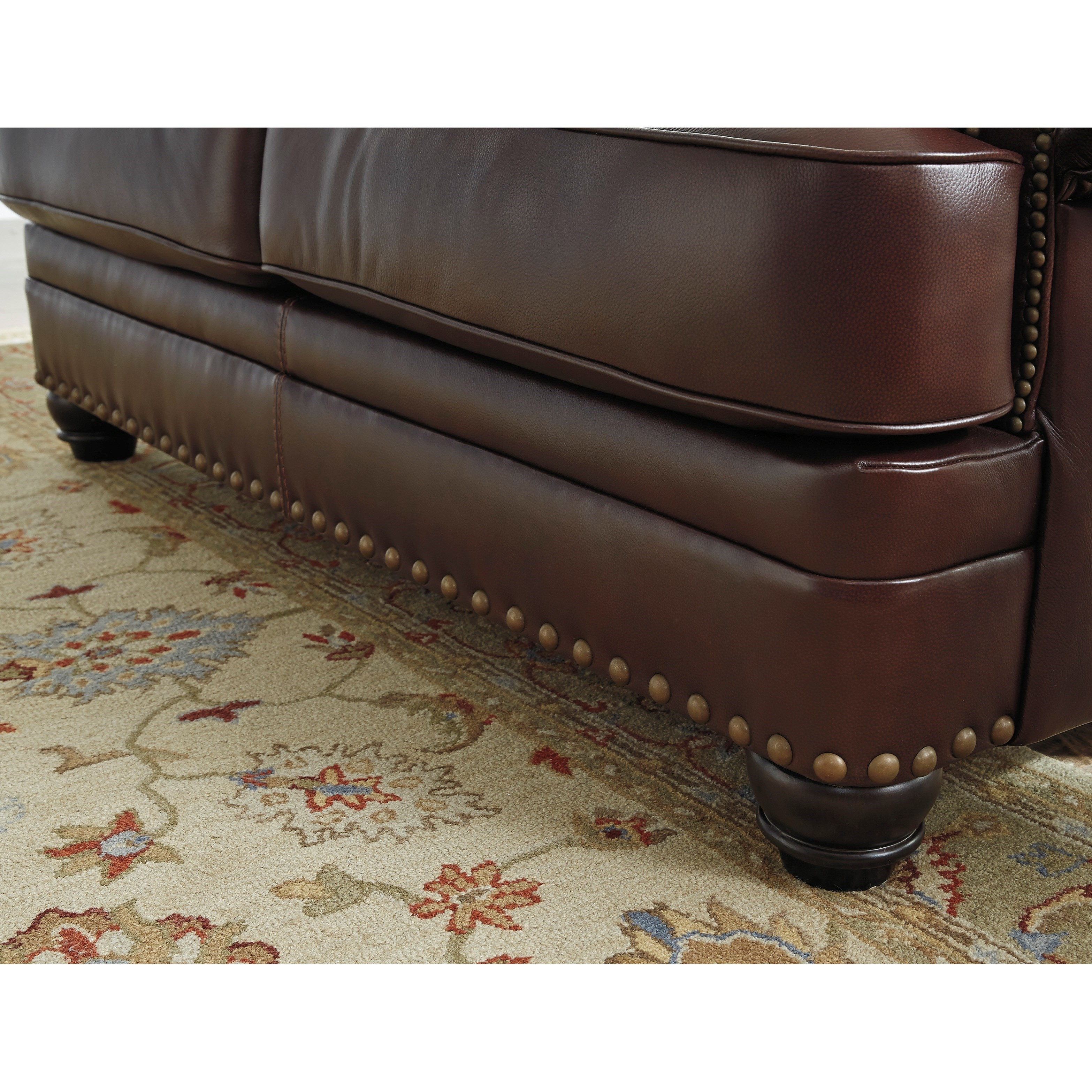 Wing Back Leather Match Sofa with Coil Seat Cushions by Signature