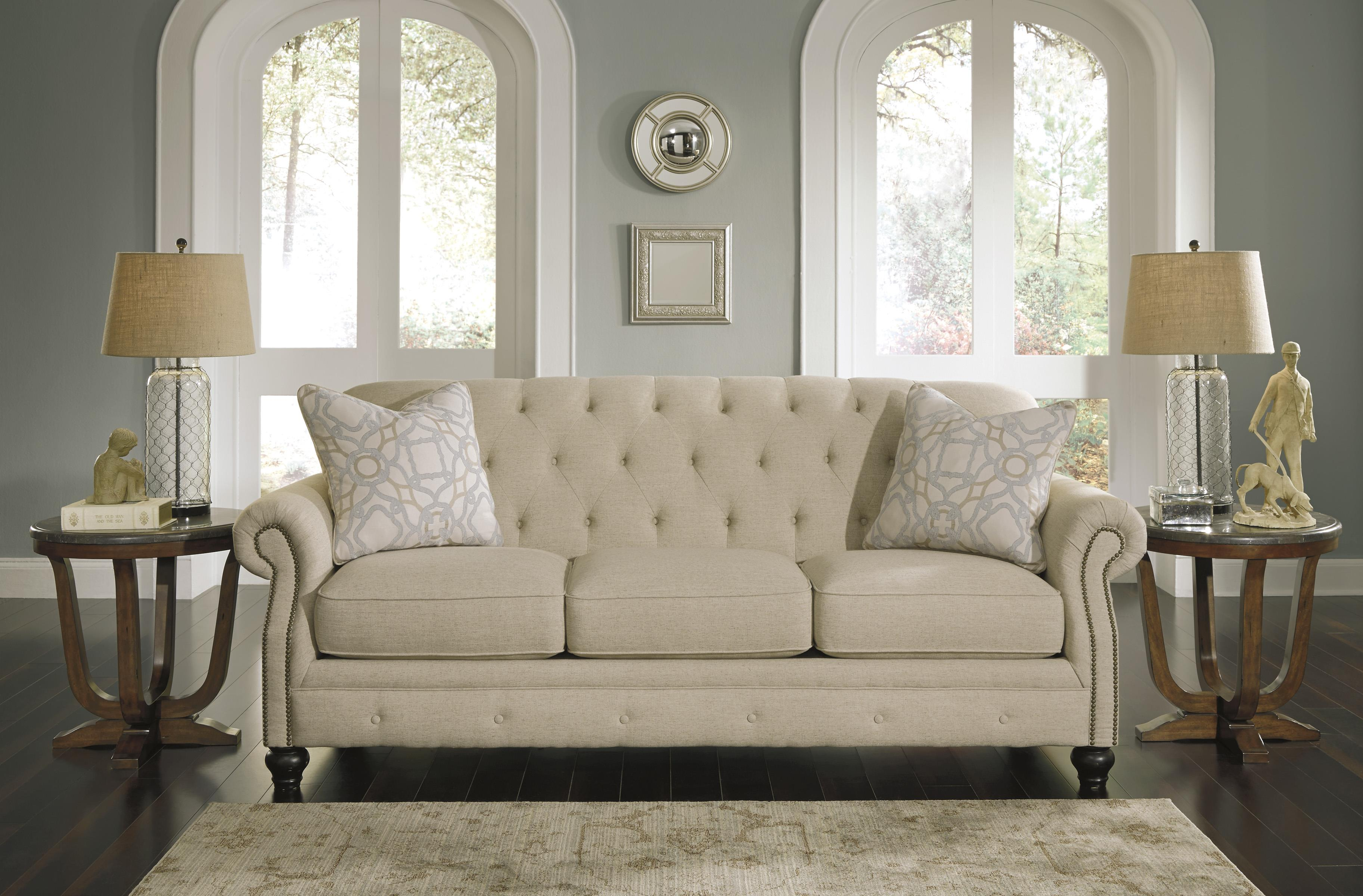 Traditional Sofa With Tufted Back And Feather Blend Accent