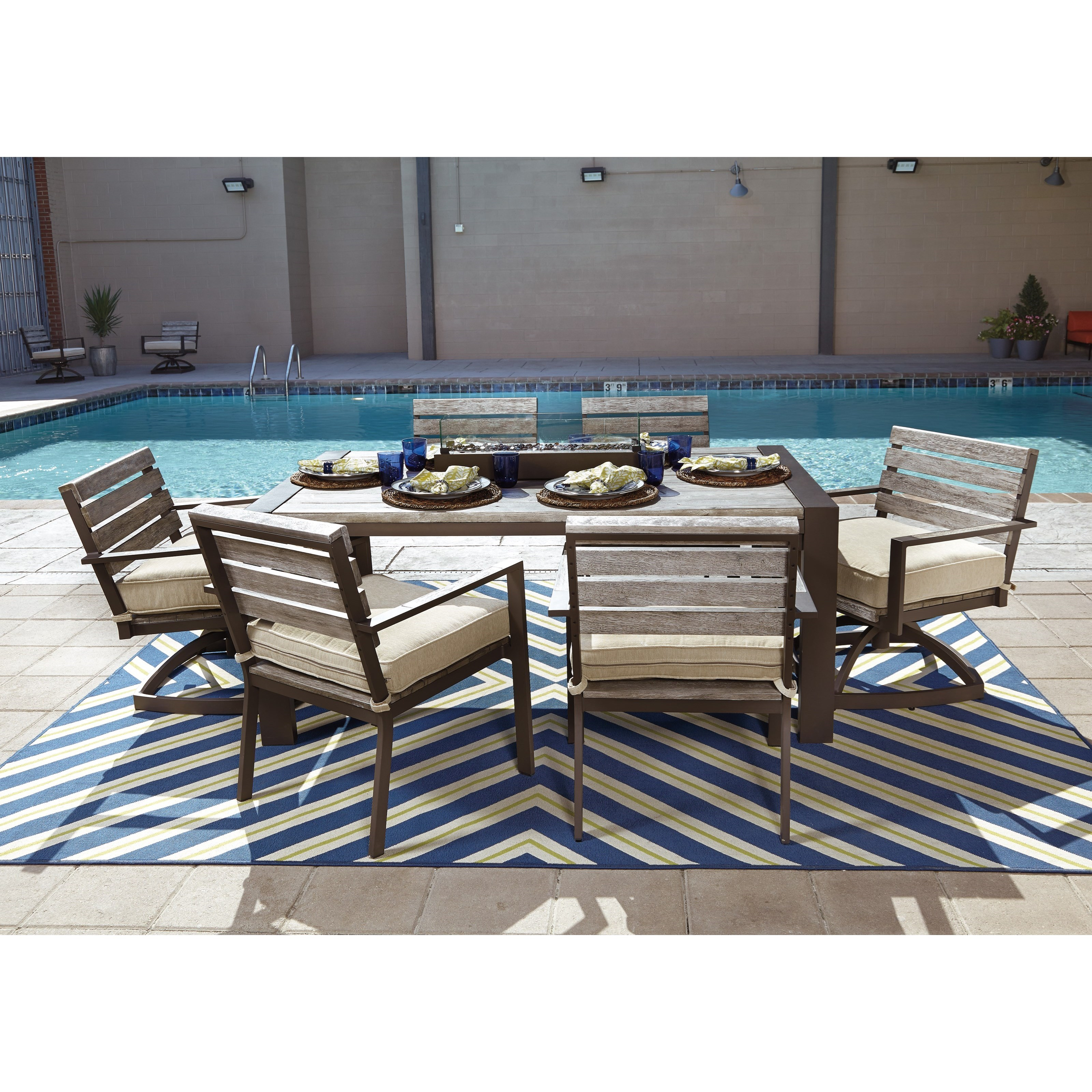 Outdoor Dining Table Set with Swivel Chairs by Signature Design by