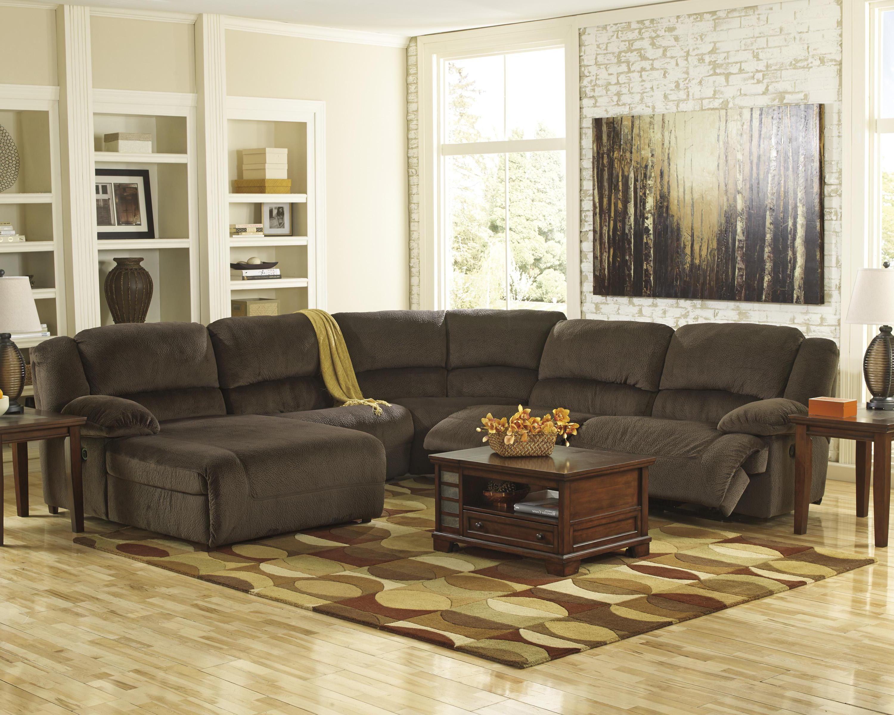 Reclining sectional with left press back chaise by for Ashley furniture sectional sofas chaise