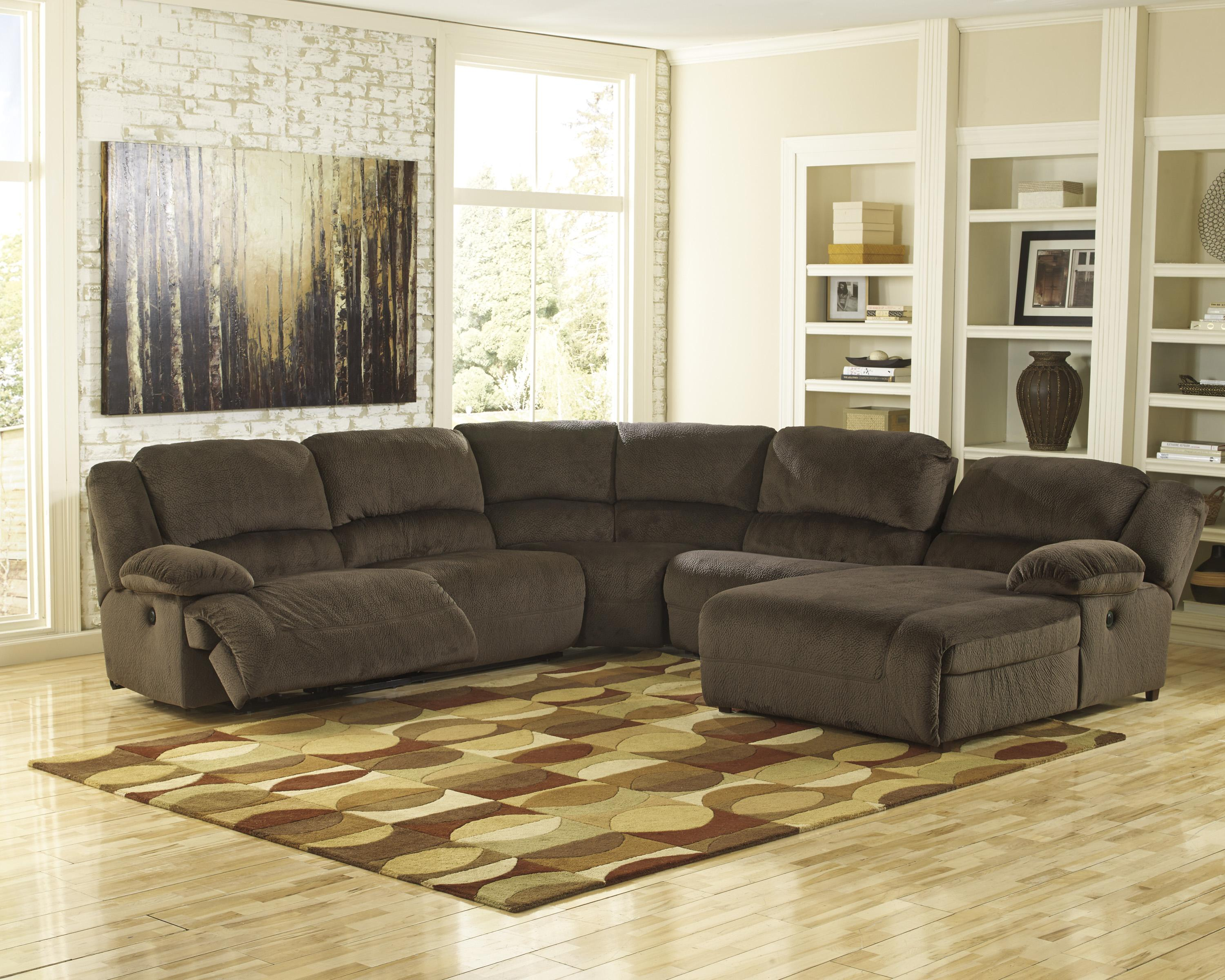 Power reclining sectional with right press back chaise by for Ashley sofa chaise