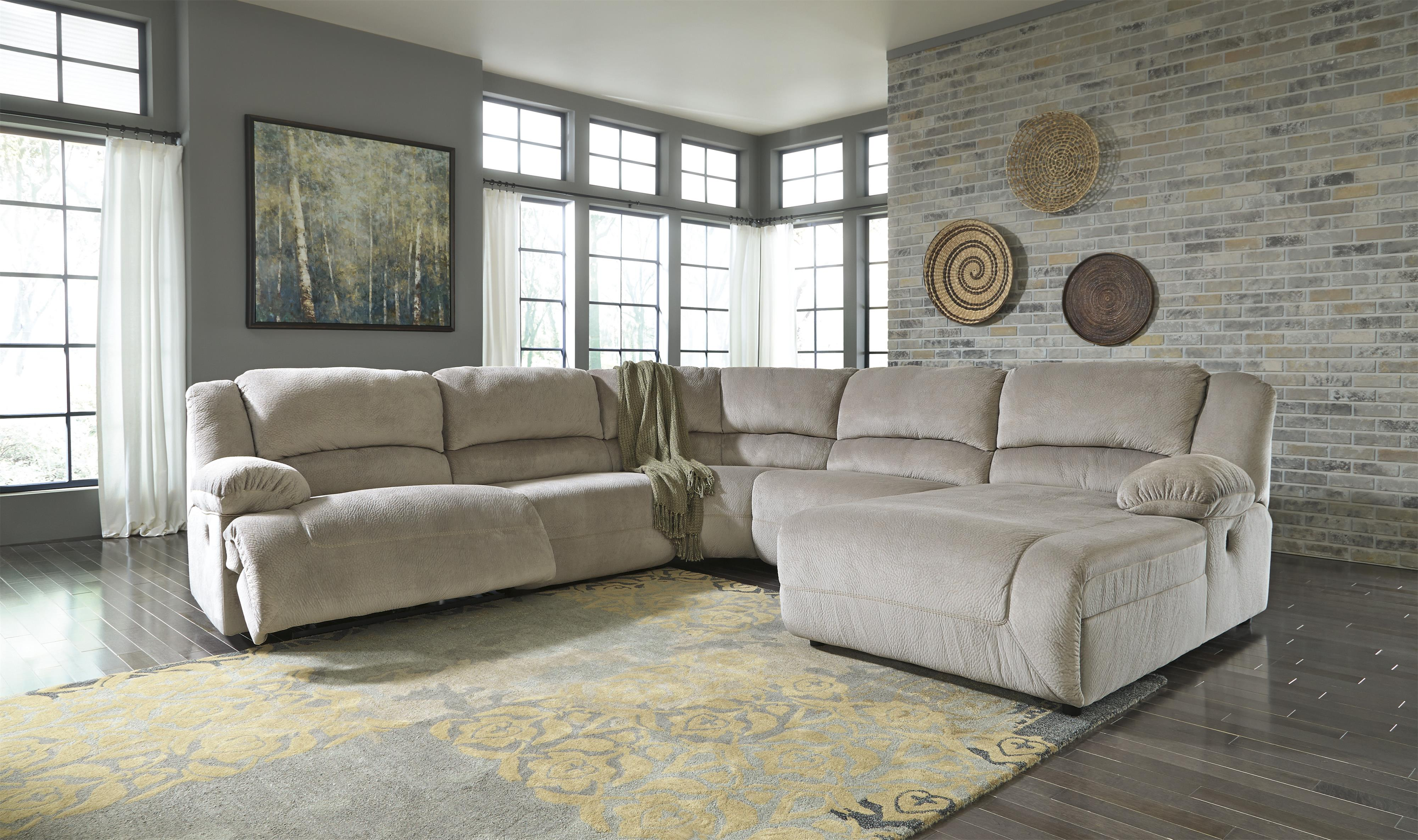 Power reclining sectional with right press back chaise by for Ashley chaise recliner