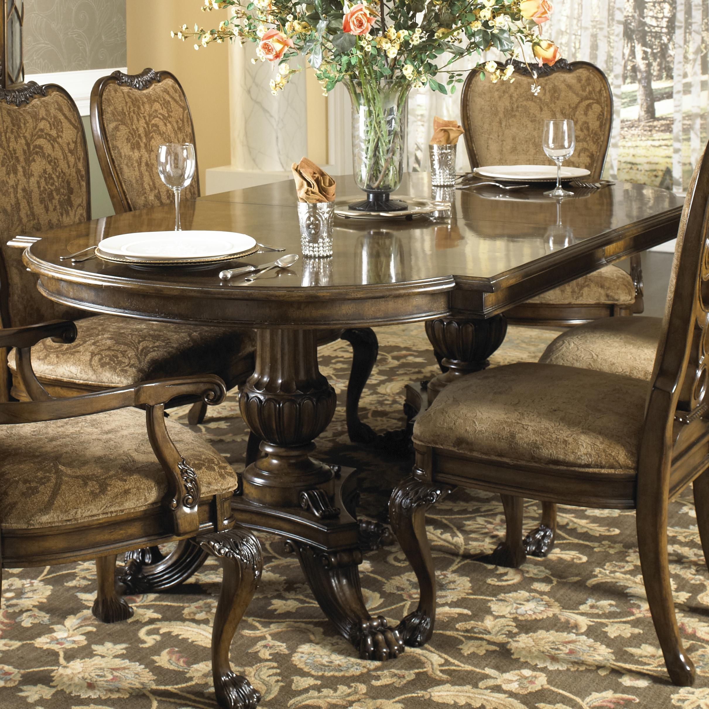 formal dining table with two hand carved pedestals by fine furniture