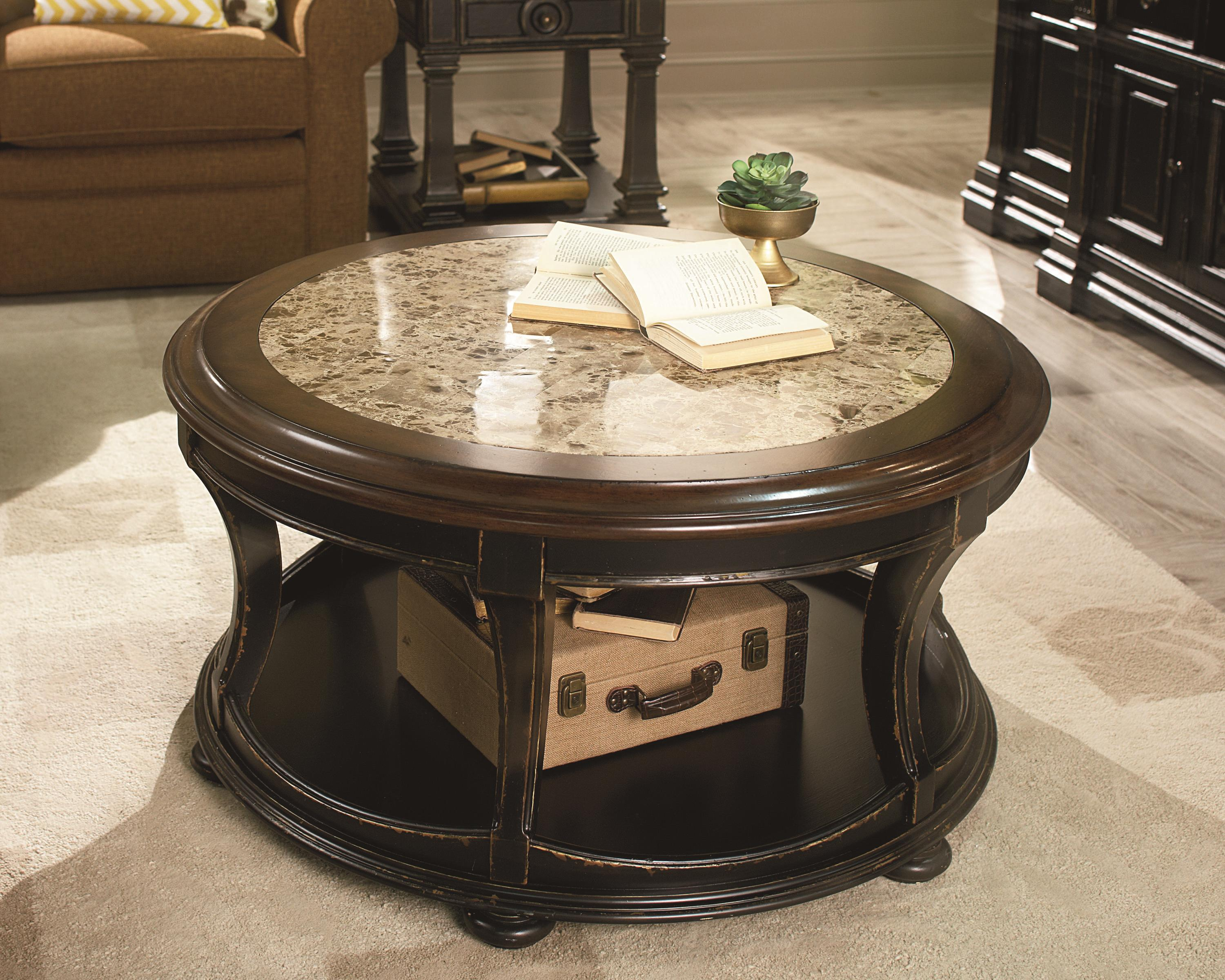 Round cocktail table with top stone inlay by hammary