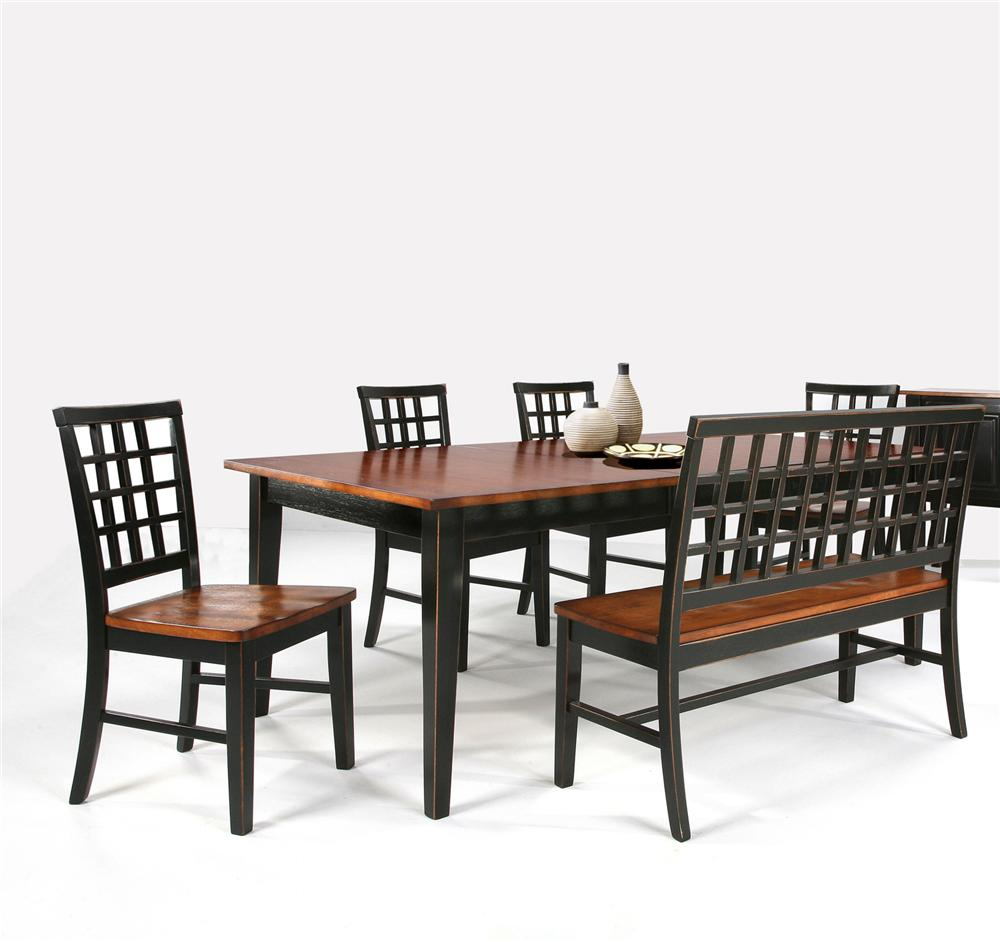 Dining table with lattice back bench side chairs by