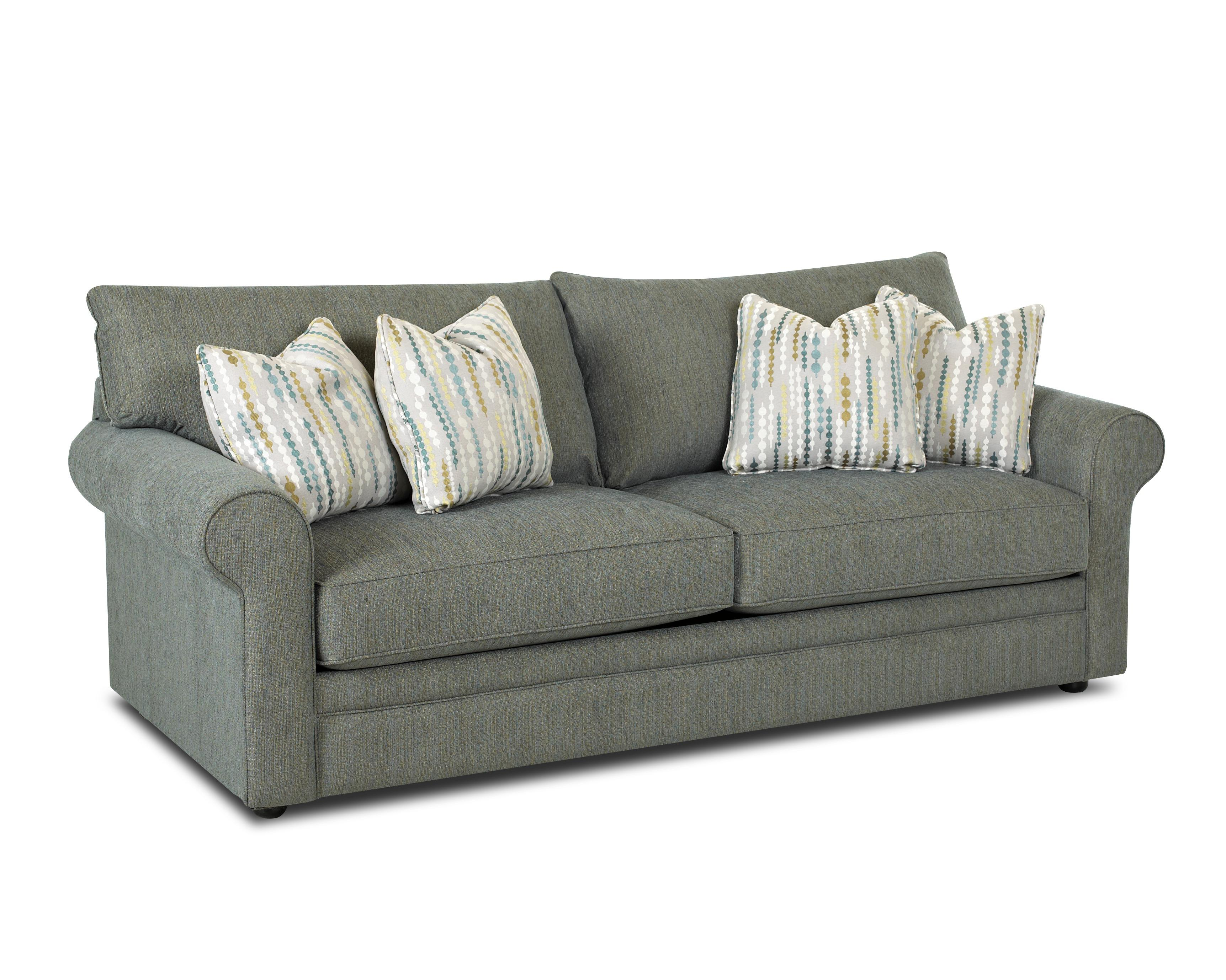 casual stationary sofa with rolled arms unattached back