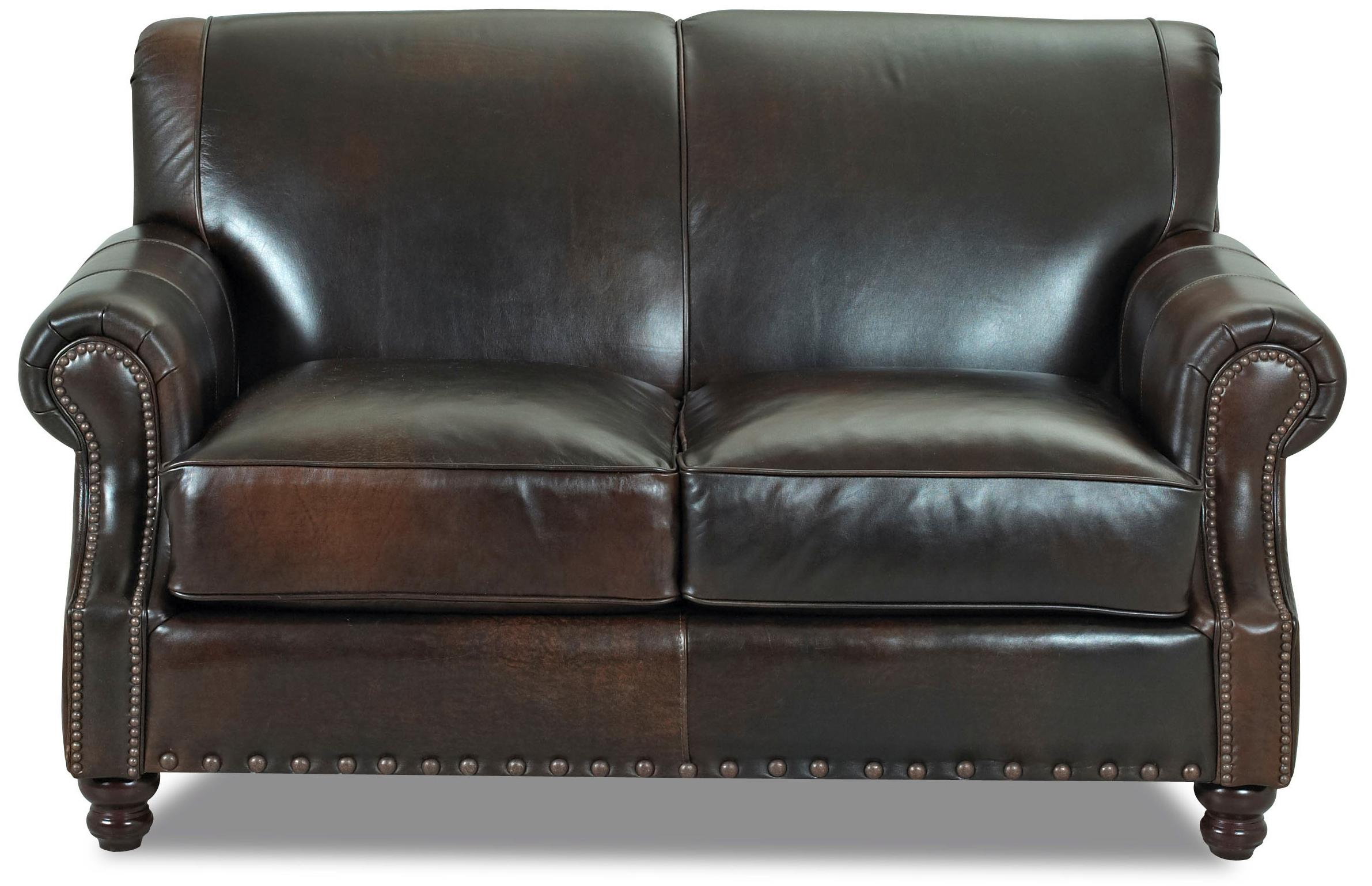 Traditional leather loveseat with nail head trim by for Traditional leather furniture