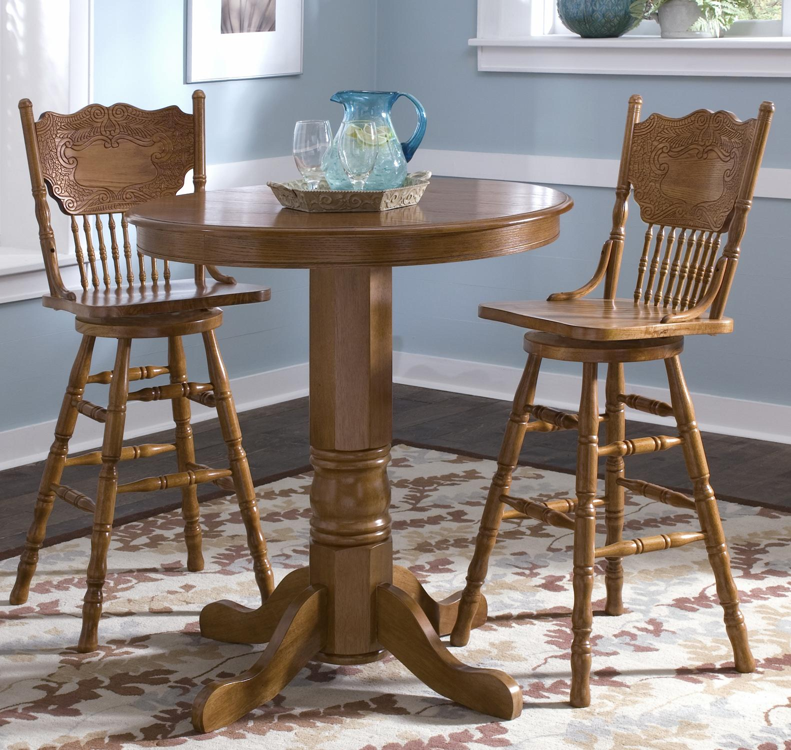 Round oak pub table by liberty furniture wolf and for Round pub table and chairs