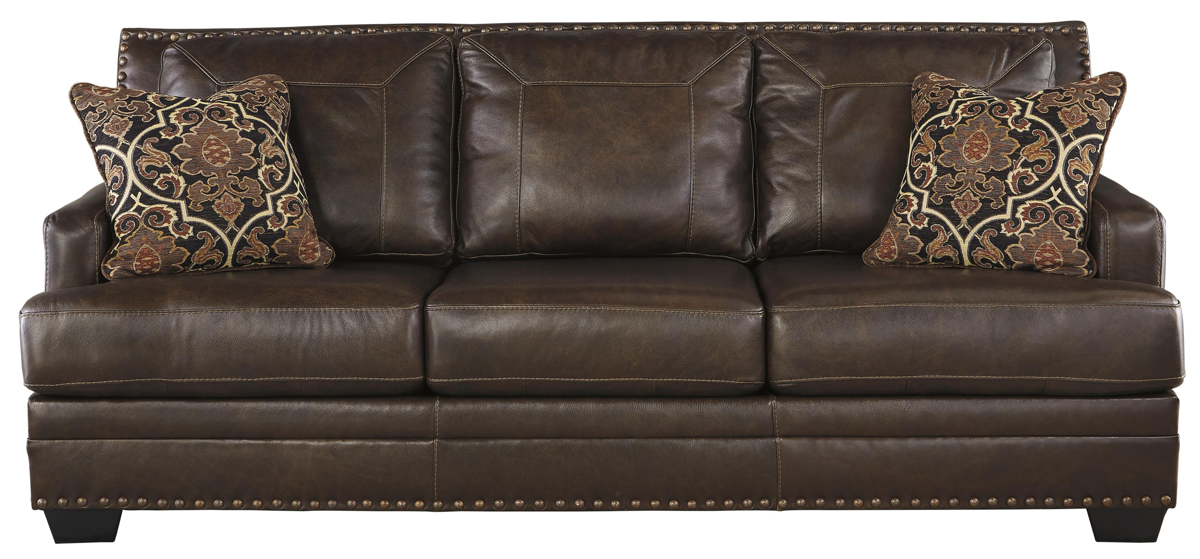 Leather match sofa with coil seat cushions by signature for Cushions for leather sofas