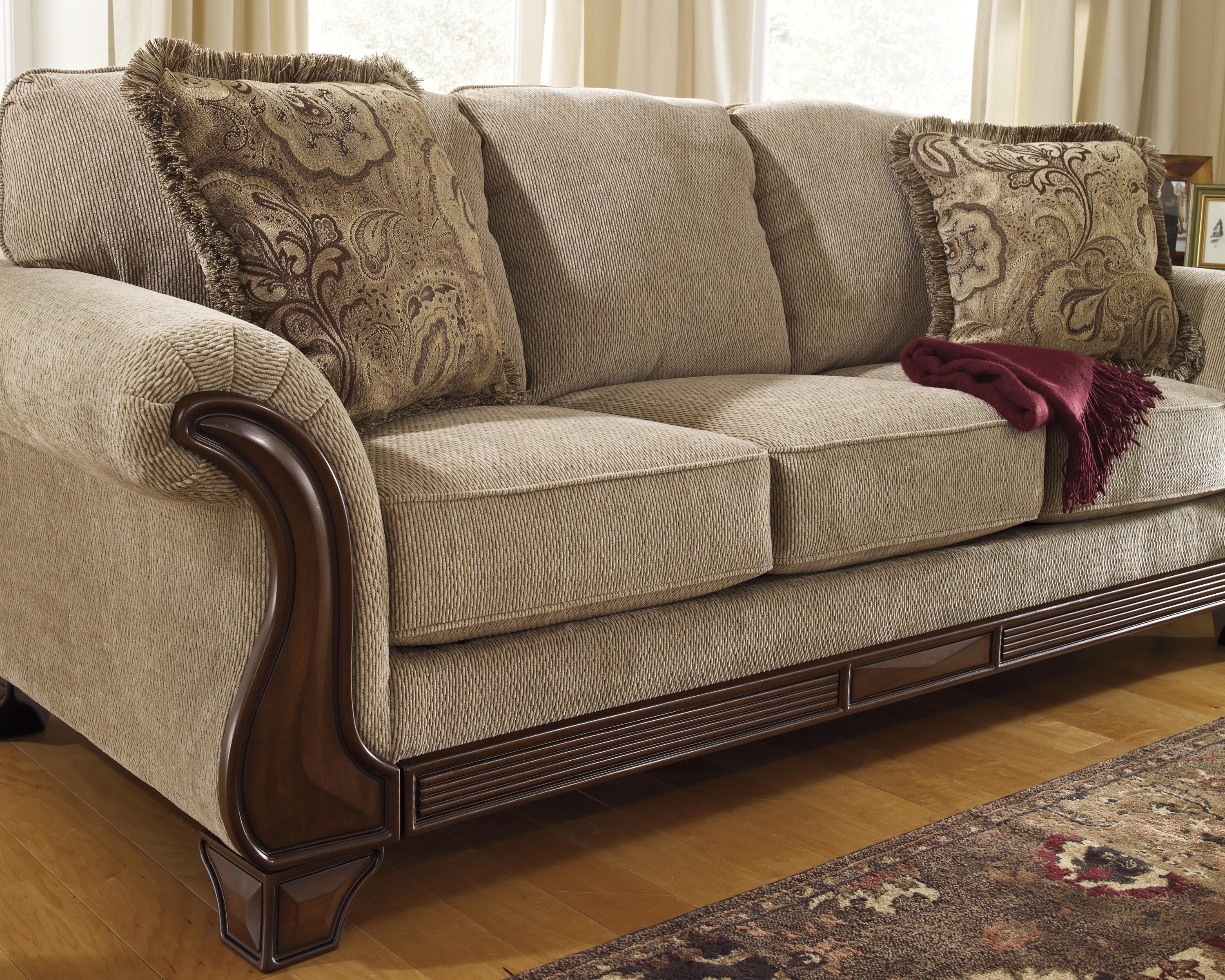 Brand new Sofa with Flared Arms & Exposed Wood Accents by Signature Design  ZR69