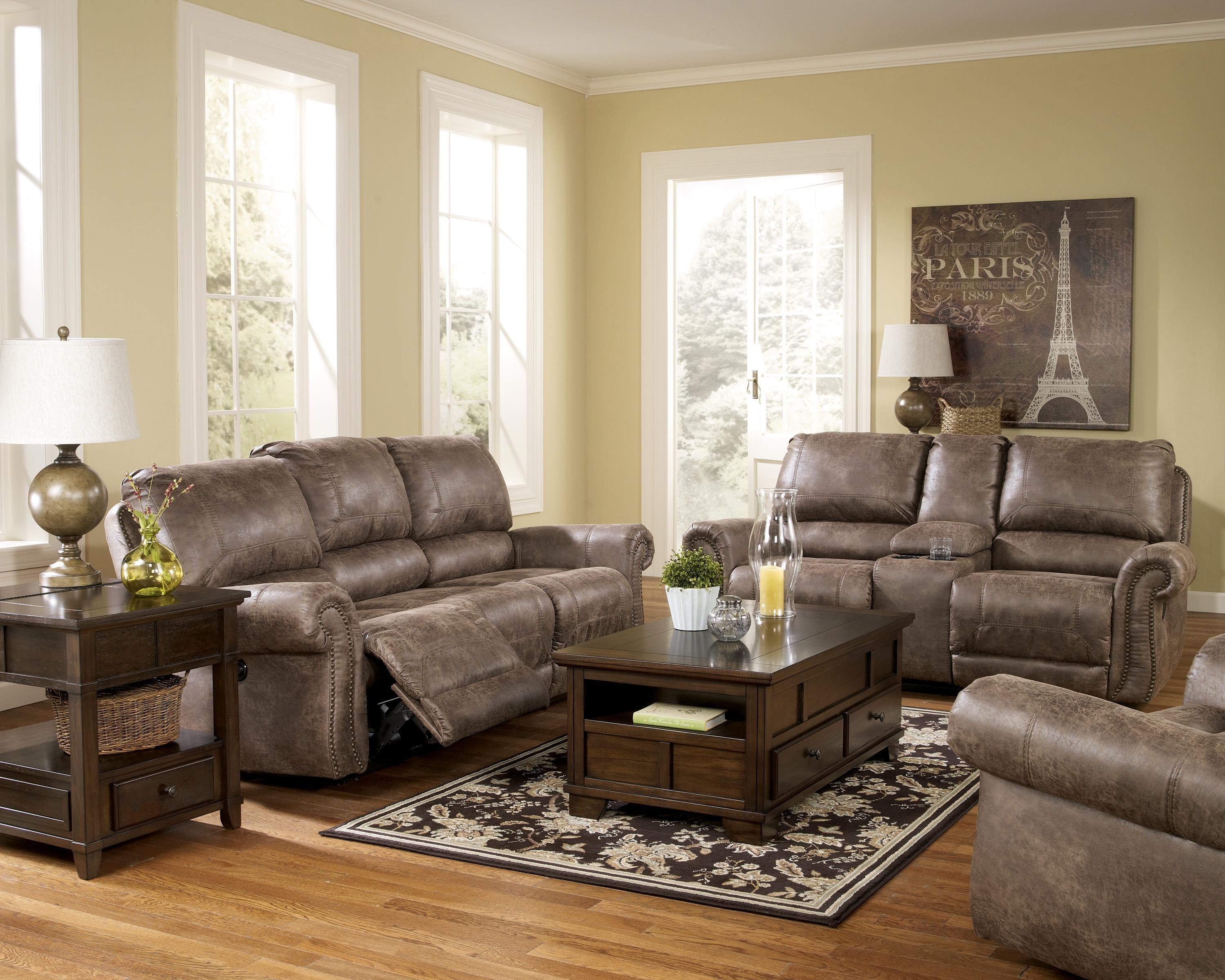 Reclining faux leather sofa with rolled arms nail head trim by signature design by ashley Ashley couch and loveseat