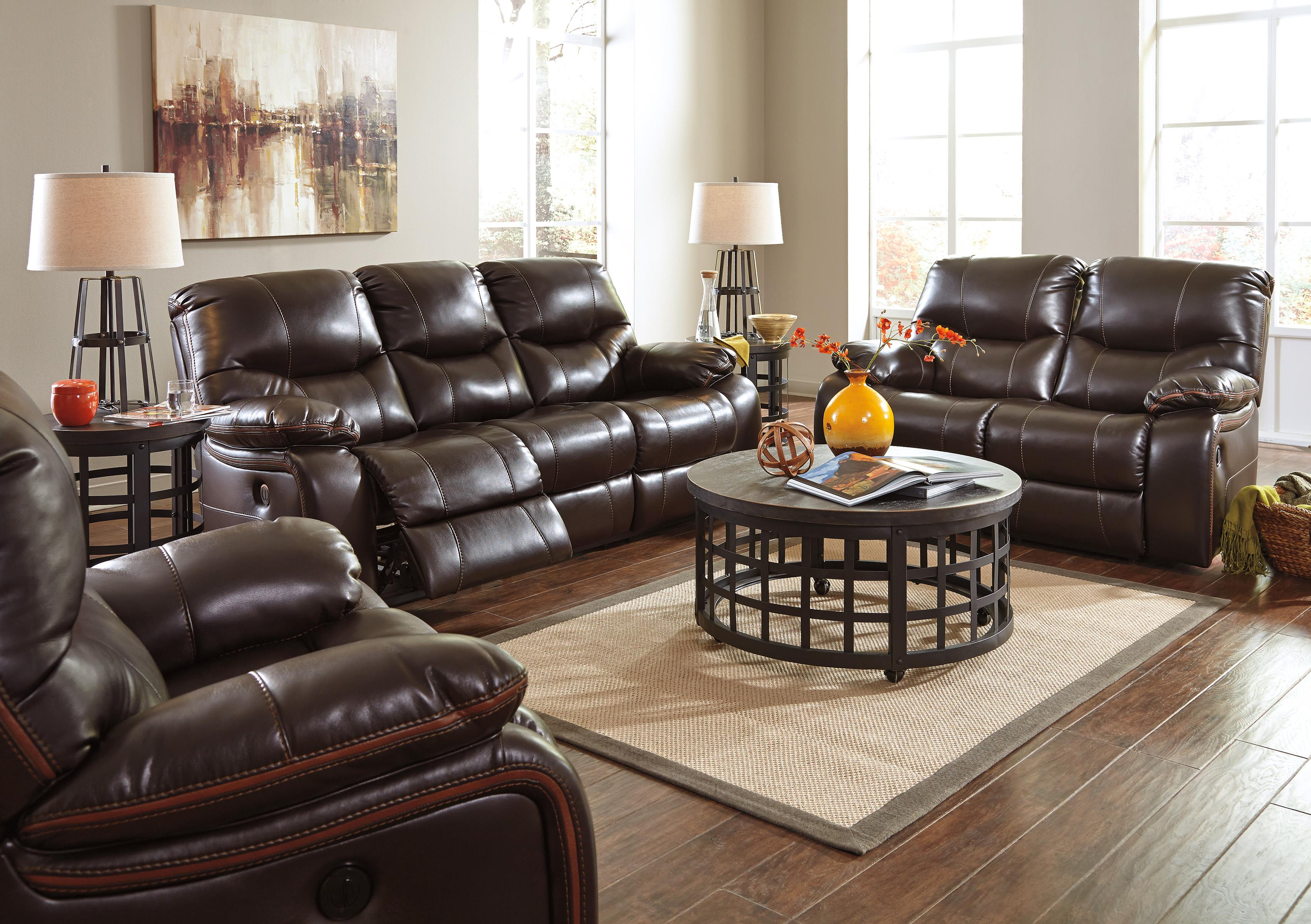 Faux Leather Reclining Sofa with Accent Trim by Signature