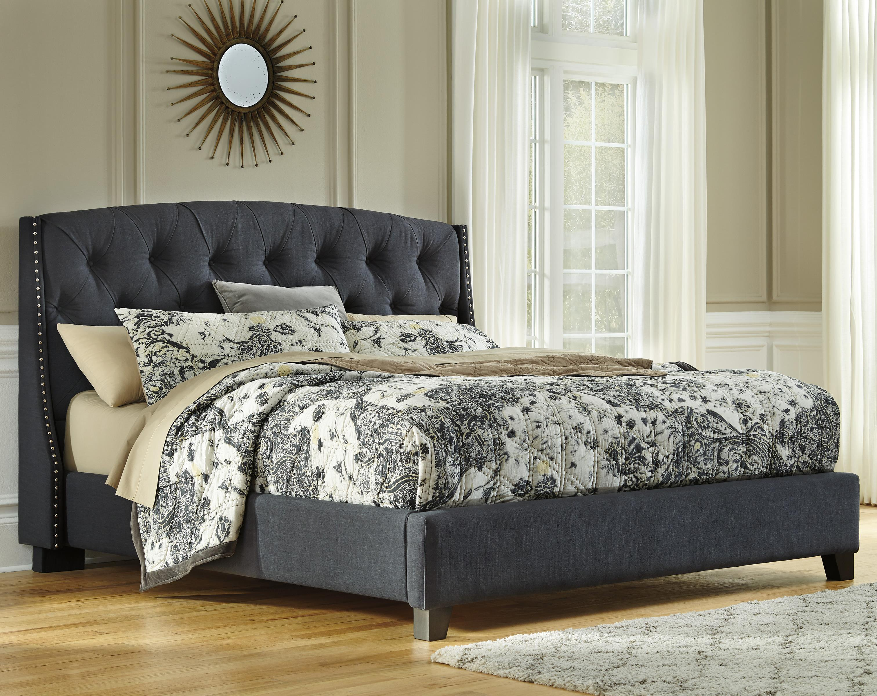 Queen upholstered bed in dark gray with tufting and nailhead trim by signature design by ashley for Bedroom sets with upholstered headboards