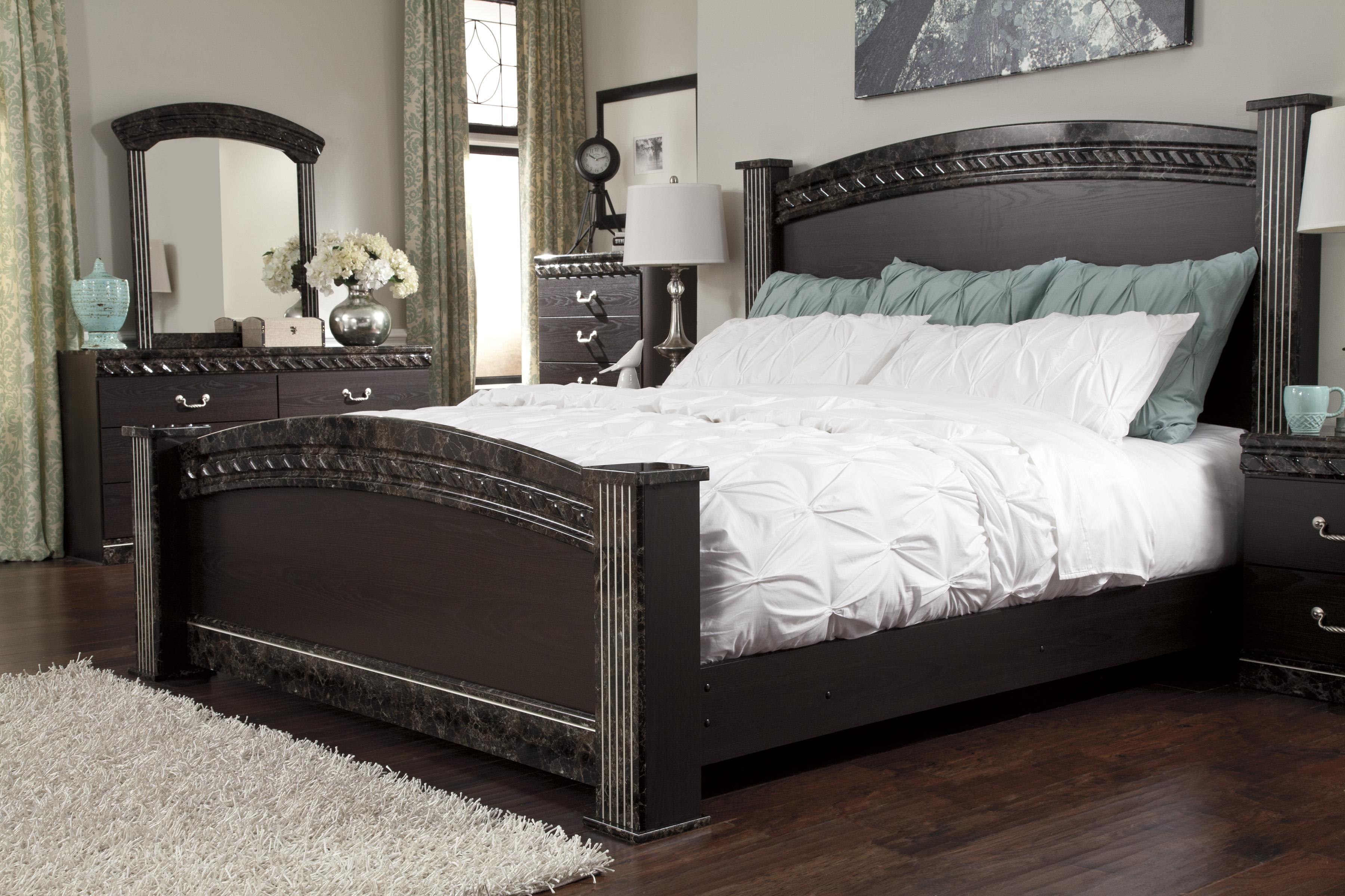 Traditional king poster bed with faux marble trim by for Ashley furniture 5 pc bedroom sets