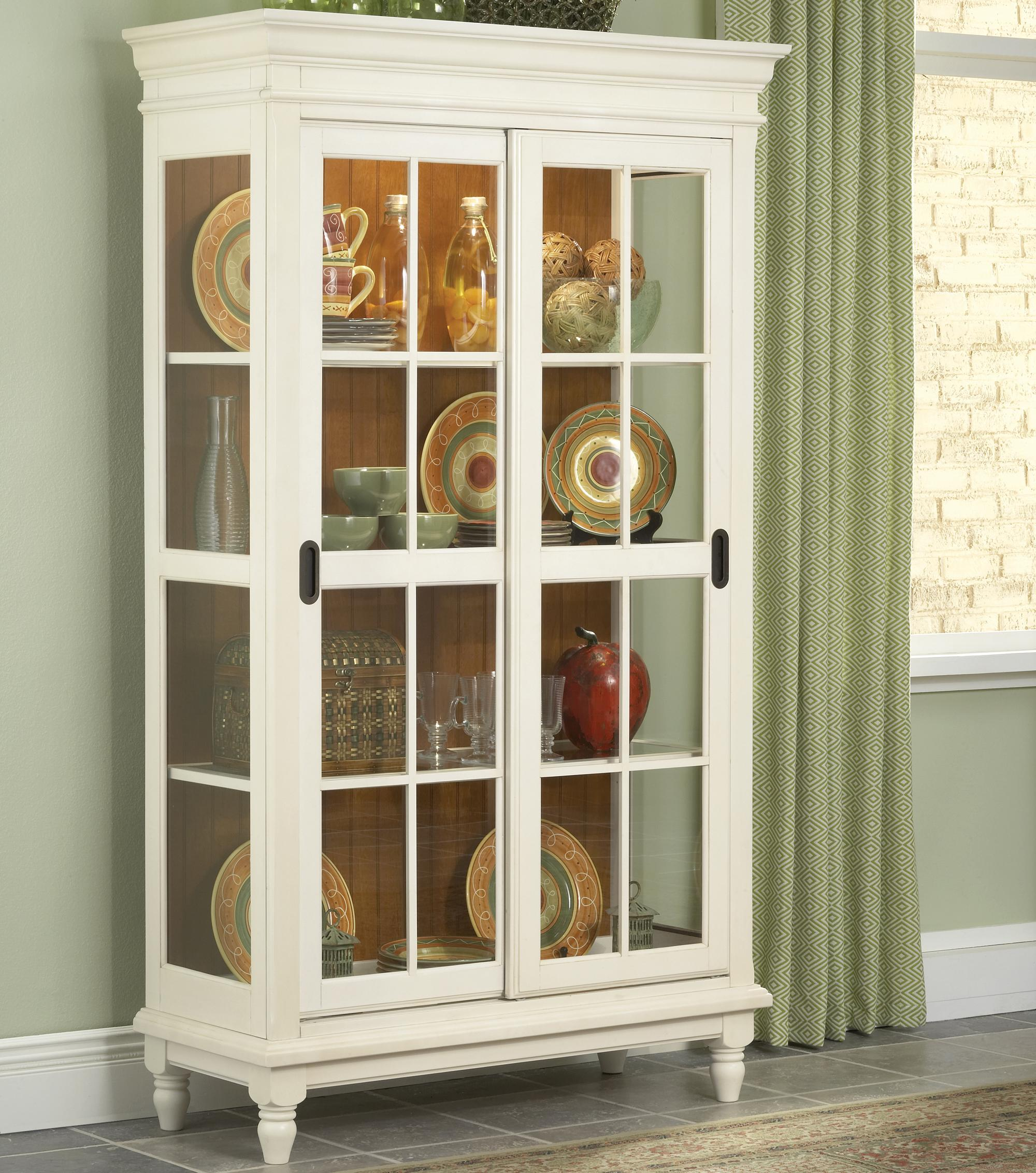 Curio Cabinet with Crown Moulding, Turned Feet, and Sliding Glass ...