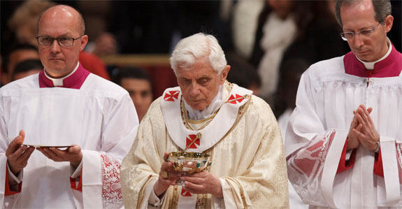Pope Benedict XVI carries the Eucharist during Holy Thursday chrism Mass in St. Peter's Basilica at the Vatican April 5. (CNS photo/Paul Haring)