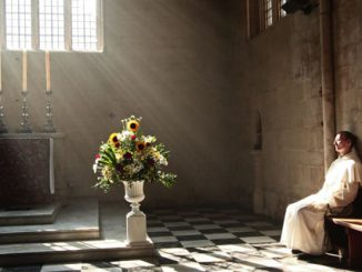 A Dominican friar prays in the presence of the Blessed Sacrament in Blackfriars church