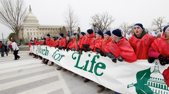 Young people walk with a banner past the U.S. Capitol during the annual March for Life in Washington Jan. 25. The pro-life demonstration marks the anniversary of the 1973 Supreme Court decision that legalized abortion across the nation. (CNS photo/Bob Roller) (Jan. 25