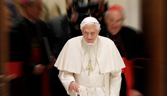 Pope Benedict XVI uses a cane as he arrives for an audience with priests of the Diocese of Rome in Paul VI hall at the Vatican Feb. 14. (CNS photo/Paul Haring; Feb. 14