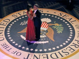 U.S. first lady Michelle Obama dances with U.S. President Barack Obama at the Commander-in-Chief Inaugural Ball in Washington Jan. 21. (CNS photo)