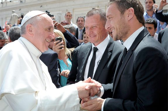 Pope Francis meets AS Roma soccer player Francesco Totti during the pope's weekly audience in St. Peter's Square at the Vatican May 22. (CNS photo/L'Osservatore Romano via Reuters)