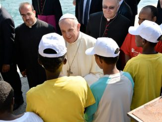 Pope Francis greets immigrants as he arrives at the port in Lampedusa