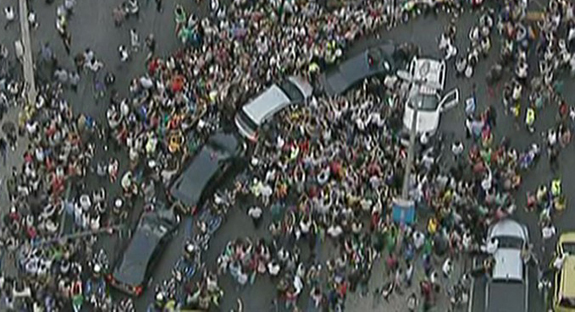 Enthusiastic crowds blocked Pope Francis' car (the silver one in the middle) as his motorcade moved through Rio de Janeiro July 22.