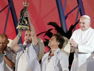 Pope Francis applauds as men re-enact the story of Our Lady of Aparecida during the World Youth Day welcoming ceremony on Copacabana beach in Rio de Janeiro July 25. (CNS photo/Paul Haring)