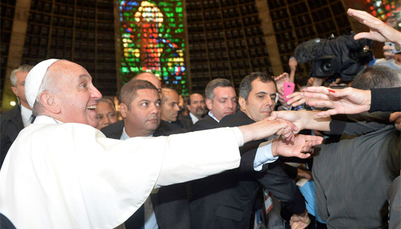 Pope Francis greets Argentine World Youth Day pilgrims at the Metropolitan Cathedral of San Sebastian in Rio de Janeiro July 25. (CNS photo/Luca Zennaro