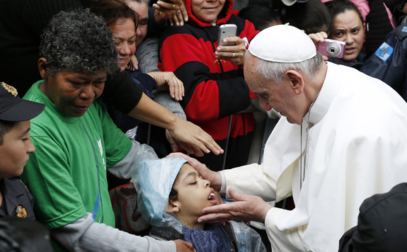 pope francis blesses a boy in the varginha slum in rio de janeiro july 25.