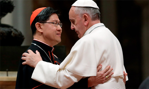 Pope Francis embraces Cardinal Luis Antonio Tagle of Manila before blessing a mosaic of St. Pedro Calungsod during a meeting with the Philippine community at St. Peter's Basilica at the Vatican Nov. 21. St. Pedro Calungsod was a lay catechist from the Ph ilippines who was martyred in Guam in 1672. (CNS photo/Alessandro Bianchi